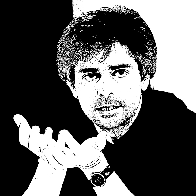 czarno-biały stylizowany portret ukraińskiego pisarza Oleksandra Bojczenko. Na zdjęciu przemawia, do kogoś poza kadrem, wzrok ma skierowany wprost na oglądającego obrazek. łokcie podparte na stole, dłonie trzyma tuż przed pokrytą zarostem twarzą w trakcie gestykulacji. Na nadgarstku ma zegarek. Ma na sobie czarną koszulę